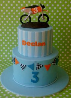 2 tier powder blue cake with dirt bike on top