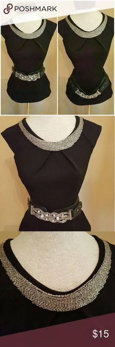 Black embellished neckline top Black top with embellished neckline that's fitting For a night out with friends. Accessorize with silver belt and your all set.. Neckline is made up of small silver beads. Says medium but fits more like a small..(belts not included) Tops Blouses