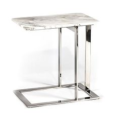 """This pretty little side table is perfect for any area in your home or office, with a beautiful white marble and stainless steel legs. Dimensions: 21.5""""w x 15""""d"""