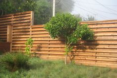 Fence Modern Designs | Fence with alternating horizontal slats gives privacy, but allows ...