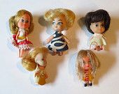 Here is a group of 5 tiny rubber dollies, they are like Liddle Kiddle dolls but none are real ones.    The dolls are 2 - 2-1/2 inches tall. One has legs that are jointed. Each has little dresses, one has a loop on her head.      Excellent condition.