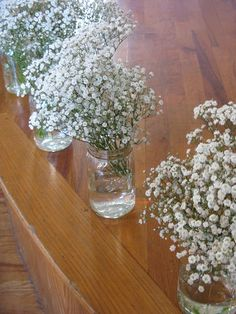 These are beautiful centerpieces! I know the time of year the wedding is will greatly influence what's available for wild flowers and such but, wow.... I like the simplicity of these a lot.