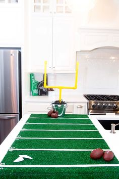 Easily make your own DIY Field Goal Post and Football Field for a fun game to use at your next football watch party, tailgating party, or birthday party.