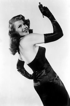 Rita Hayworth, 1946, as femme fatale Gilda, in the film of the same name.  The film was a launchpad for Rita Hayworth;  the rocket was the black satin dress designed by Jean Louis.