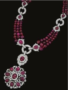 Ruby and diamond necklace/brooch combination, Designed as graduated rows of polished ruby beads, suspending to the centre a pendant/brooch of open work floral design set with cabochon rubies. Ruby And Diamond Necklace, Ruby Necklace, Ruby Jewelry, Diamond Pendant, Diamond Jewelry, Beaded Jewelry, Jewelery, Fine Jewelry, Beaded Necklace