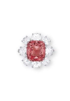 0885bb9c A PADPARADSCHA SAPPHIRE AND DIAMOND RING. Designed as a flower head,  centering upon a