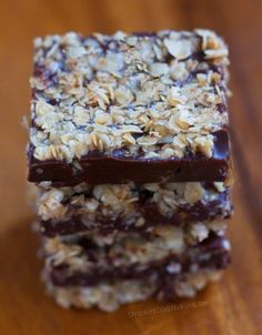 Oatmeal Fudge Bars - These gooey fudge bars are ADDICTIVE!!! ... Trust me, you should bookmark this recipe... I made two trays, and both were gone within an hour! ... @choccoveredkt https://chocolatecoveredkatie.com/2016/02/08/oatmeal-chocolate-fudge-bars/