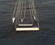 Isabela Rocca's signature tag bar necklaces