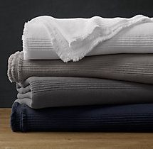This one is only $125....lighter weight    Ribbed Cotton Oversized Bed Throw