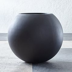 Sale ends soon. Add modern geometry to outdoor spaces with our sculptural round planters in garden-friendly grey.