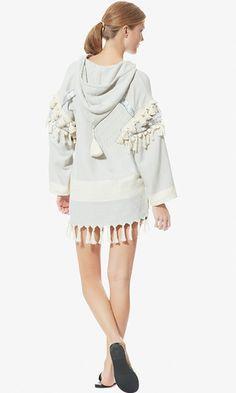 Boho goes sophisticated in this oversized, neutral baja sweatshirt embellished with tassels.