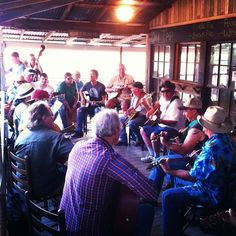 Pickin' circle on the porch every First Friday at LarryLand's music store BastropTXEDC, via Flickr