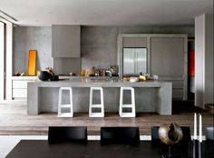 Box shape and designed to blend, modernist kitchens tend to minimize the impact of vent hoods.