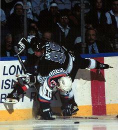 Nov. 22, 1995: New York Islander Darius Kasparaitis upends Wayne Gretzky. (Photo by Brian Winkler/Getty Images)