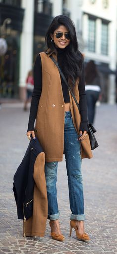 Fall / Winter - street chic style - black turtle neck sweater + camel long vest + boyfriend jeans + camel stilettos + black and camel jacket + aviators