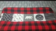 Bear, moose, and lumber jack changing pad cover.