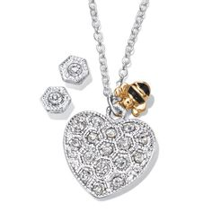 "Bee mine! Silvertone heart pendant necklace embellished with sparkling rhinestones and a companion goldtone bee charm. Comes with rhinestone stud earrings.· Necklace: 16 1/2"" L with Lobster Claw clasp· Extender: 3 1/2"" L with spring ring clasp· Pendant: Removeable, approx. 25/32"" x 13/16""· Earrings: Pierced, approx. 1/4"" with Post with Bullet clutch· Imported"