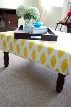DIY upholstered ottoman made from a thrift store coffee table; includes tutorial
