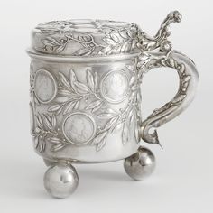 A Fabergé Silver Tankard with Coins, Workmaster Julius Rappoport, St. Petersburg, circa 1897-1899.