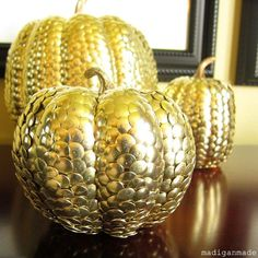 Gold thumbtack covered pumpkins for fall http://www.madiganmade.com/2011/09/gold-thumbtack-covered-pumpkins-for.html