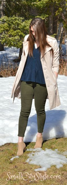 Trench coat, navy peplum top, olive skinny jeans, beige ankle boots