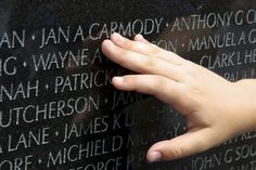 Aren points to the name of his grandmother's cousin on the Vietnam Memorial in DC