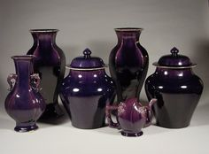 A grouping of aubergine glazed porcelains