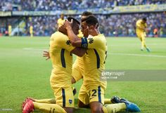 Carlos Tevez of Boca Juniors celebrates with teammates Cristian Pavon and Nahitan Nandez after scoring the first goal of his team during a match between Boca Juniors and San Martin de San Juan as part of the Superliga 2017/18 at Alberto J. Armando Stadium on February 25, 2018 in Buenos Aires, Argentina.