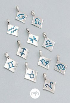 Celestial Sign Zodiac Pendants - According to astrology, your personality is written in the stars. Now it's written in your style too! These kite-shaped charms of sterling silver feature the 12 zodiac symbols in sparkling blue enamel. Choose a pendant for your sign, and like the celestial bodies above, go ahead and shine! Double U, Band Wallpapers, Zodiac Tattoos, Meaningful Jewelry, Zodiac Symbols, 12 Zodiac, Diy Necklace, Kite, Sparkle