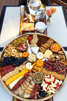 Fall Epic Charcuterie Board for casual entertaining, filled with pumpkin treats, best cheese and cured meats, with fruits, nuts, and crackers! #epic #epiccharcuterie #fallcharcuterie #charcuterieboard #partyfood #fallfood #appetizer #halloween