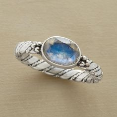 INNER LIGHT RING--Our exclusive inner light moonstone ring with shining moonstone seems to glow with its own light. Oxidized sterling silver band. Whole sizes 5 to 10.