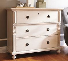 Off white dresser (vintage style?) with light distressing an possibly a dark stained top