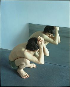 Crouching Boy in Mirror by Ron Mueck