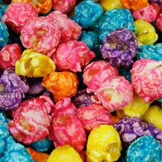 Rainbow popcorn! So fun to eat during a movie night..not to mention that it looks pretty in the party bowl! #Snacks #Popcorn #Movies