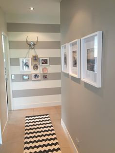 Finally finished the hallway - tick. Painted stripes at end of hallway. Picked up the odds and sods frames from second hand shops to create a unique collage on the stripe wall. Paint = Double Tea (Resene)
