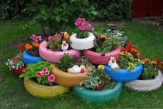 I'd paint them black to showcase the plants! The old car tires are widely used in the garden – you can use them as flower pots, or make a playground for the kids with them.