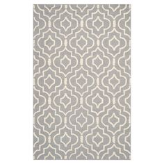 Showcasing a quatrefoil motif in silver and ivory, this wool rug anchors your living room or master suite in classic style.  Product...