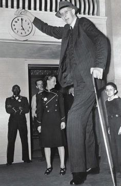 Robert Wadlow is the tallest person in history. Wadlow reached 8 feet 11.1 inches in height. He died in 1940 aged 22.