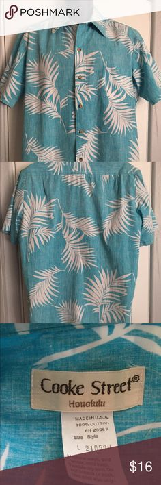 Vintage Cook Street Hawaiian Aloha Shirt For the man who looks great in blue! Vintage made in the USA Hawaiian 🌺 shirt by Cook Street. Reverse print turquoise and white leaves pattern. Wood buttons. Excellent condition. Size large but vintage large is more like a medium. Cook Street Shirts Casual Button Down Shirts