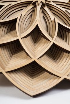 This layered wood mandala, designed by Morgan Doane, pays tribute to the rich tradition and history of Islamic Geometric Design. Wooden Art, Wood Wall Art, Paper Structure, Laser Cutter Ideas, Origami Architecture, Motif Art Deco, Bamboo Lamp, Islamic Patterns, Chip Carving