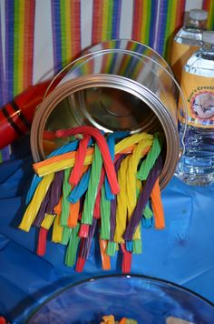 Empty Paint can stuffed with coloured Twizzlers to look like colourful paint sticks.  Cheap and easy look for Crayola Birthday Party.