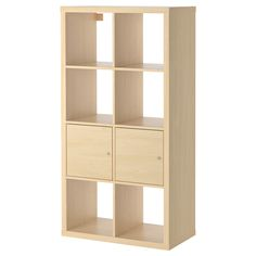 Definitely considering buying this KALLAX Shelving unit with doors from IKEA.
