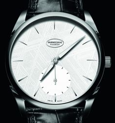 """Parmigiani Tonda 1950 Meteorite Watch - by Patrick Kansa - just announced, see & read all about it on aBlogtoWatch.com """"The new white-faced Parmigiani Fleurier Tonda 1950 Meteorite watch joins two previous versions of the meteorite-dialed watches which came in darker colors of dark blue and black. This new version comes from a meteorite discovered in Sweden, which delivers a uniquely icy look..."""""""
