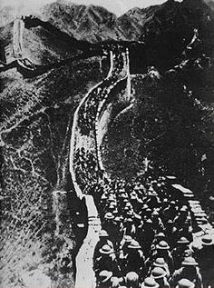 Chinese soldiers march along the Great Wall of China after the July 7th Incident, or the Marco Polo Bridge Incident (1937). Public domain photograph.