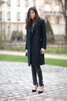 Barbara Martelo in a black coat + leather leggings + black heels