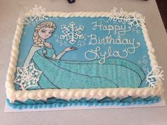 """Frozen Elsa Buttercream Sheet Cake with white chocolate snowflakes and hard candy """"ice crystals"""" on the sides. Elsa Birthday Party, Frozen Birthday Cake, Frozen Theme Party, 4th Birthday, Birthday Ideas, Frozen Sheet Cake, Pastel Frozen, Birthday Sheet Cakes, Elsa Cakes"""
