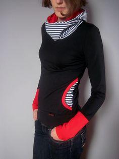Mikinka s kapsami černá,červená,proužek M Mikinka je ušitá z pružného bavlněného úpletu s elastanem. Na bocích jsou všité barevné kapsy, kapuca je dvojitá a rukávy jsou ozdobeny dlouhými barevnými náplety. Barva je černá, kapuca a kapsy černobílý proužek, v kapuci červená, rukávy červená Velikost M: délka 66cm, délka rukávu 68cm, přes prsa 48cm, pas 44 cm, ...