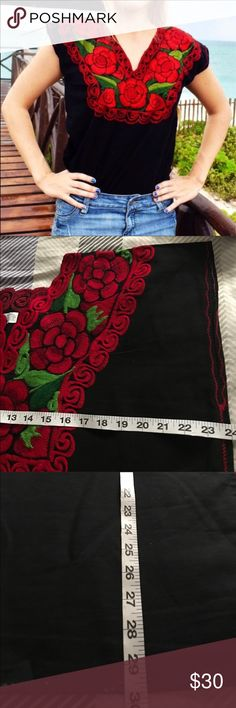 """New Mexican Embroidered Blouse Black & Red Flowers New. Made in Chiapas, Mexico by native artisans.  Absolutely beautiful floral top! Eye-catching red floral embroidery over black fabric. A favorite from our customers!   Measurements:  Armpit to armpit Small 19"""" / Lenght 26"""" Medium 20""""   Large 21"""" / Lenght 27"""" XL 22""""  XXL 23.5"""" / Lenght 29"""" XXXL 25"""" 4XL 26.5"""" undefined Tops Blouses"""