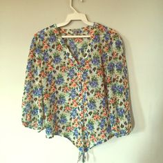 Charlotte Russe floral sheer tie blouse! SPRING Beautiful sheer floral blouse by Charlotte Russe. Tie in the front for a crop effect. Buttons up as well. Cute color. Perfect with jeggings and wedges or high waisted shorts! Spring essential! Charlotte Russe Tops Blouses