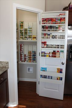Love our pantry! New indoor spice rack holder and rotating can dispenser! Our walk-in pantry is awesome!!! So thankful for all the new cabinet and drawer space that has now been freed up!  Thanks Hubby! :)
